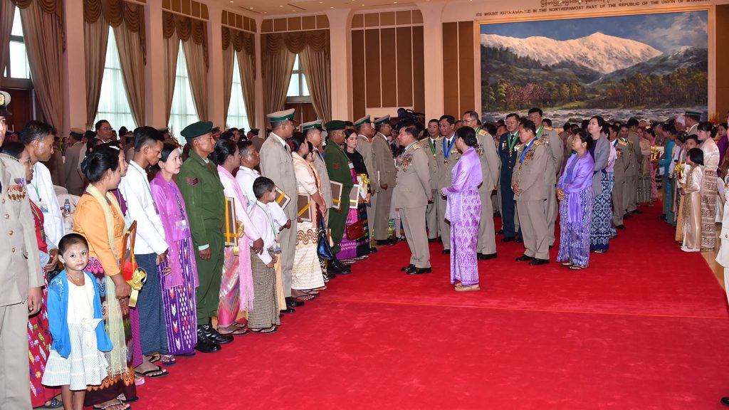 Commander-in-Chief of Defence Services Senior General Maha Thray Sithu Min Aung Hlaing greets the outstanding Tatmadaw members and families.Photo: Office of the C-In-C of Defence Services