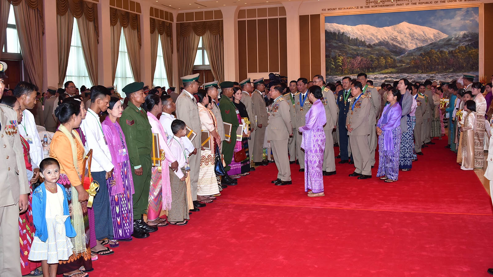 Commander-in-Chief of Defence Services Senior General Maha Thray Sithu Min Aung Hlaing greets the outstanding Tatmadaw members and families. Photo: Office of the C-In-C of Defence Services