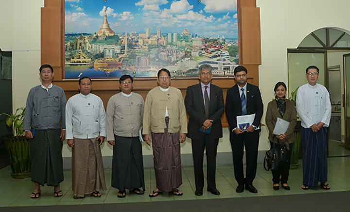 Union Minister Dr Pe Myint poses for a photograph with a delegation led by Indian Ambassador Mr Saurabh Kumar in Nay Pyi Taw yesterday. Photo: MNA