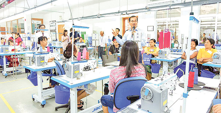 An instructor is giving lecture at Aung Myin Hmu Garment Skills Training Centre.   Photo: AMH