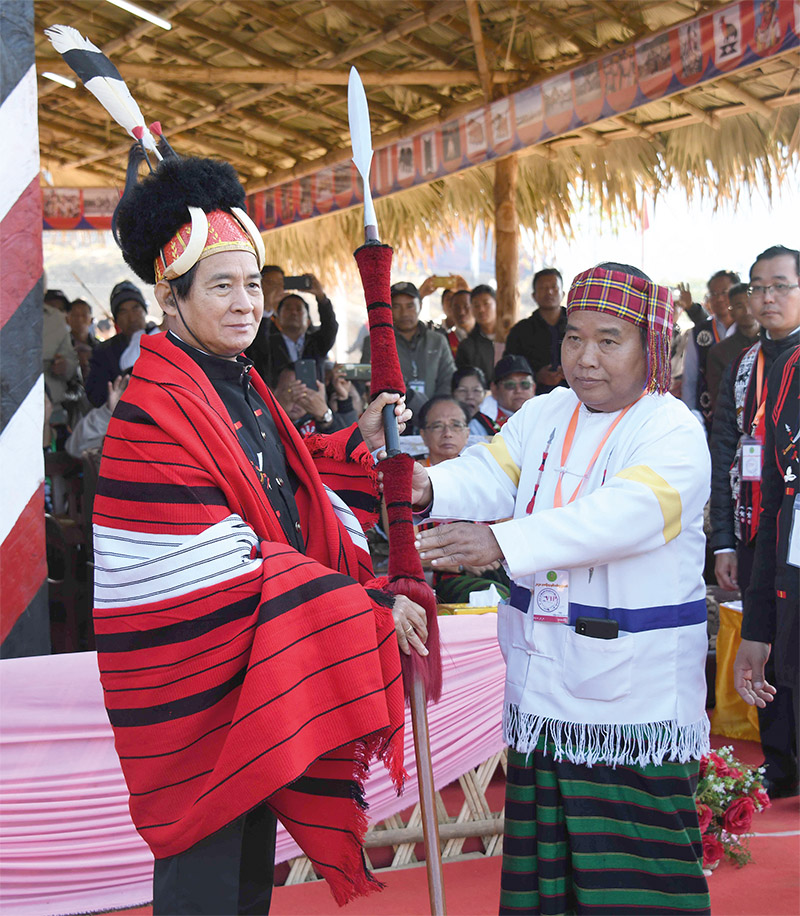 President U Win Myint accepts a traditional spear presented by a local leader at the Naga Traditional New Year Festival.Photo: MNA