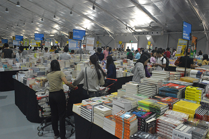 People observe books at booths at the Big Bad Wolf, the world's biggest book sale in Thakayta Township, Yangon.photo: Kyaw Zeya