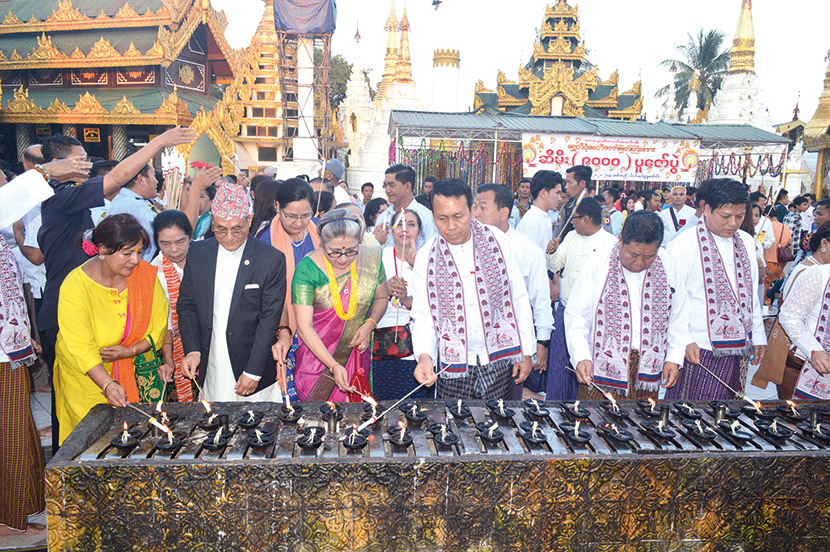 Yangon Region Chief Minister U Phyo Min Thein, Nepalese Ambassador Mr Bhim K. Udas and attendees lit the oil lamps at the Shwedagon Pagoda.  Photo: Kyaw Zeya