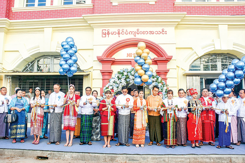 Vice President U Henry Van Thio and dignitaries cut ceremonial ribbons to open the main building of The Bible Society of Myanmar in Kyauktada Township, Yangon.  Photo: MNA