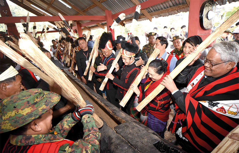 President U Win Myint, First Lady Daw Cho Cho, officials and Naga ethnic people struck the traditional drum at the Naga New Year Traditional Festival 2020 in Lahe in the Naga Self-Administered Zone, Sagaing Region yesterday.Photo: MNA