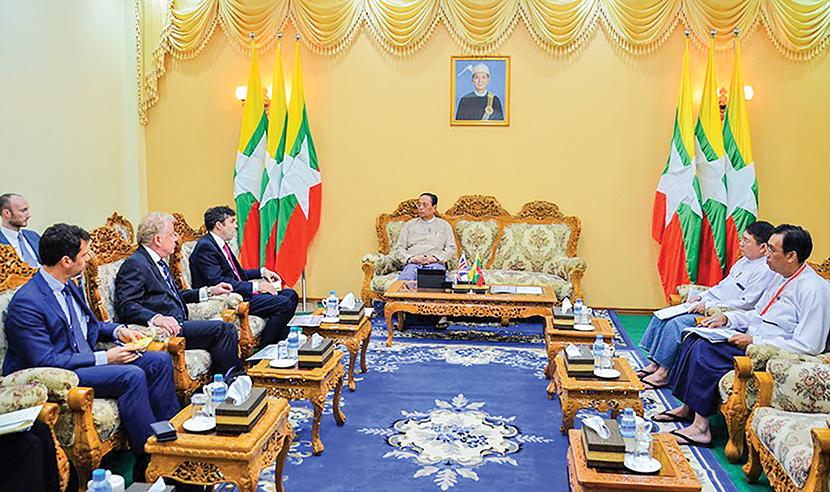 Union Minister U Win Khaing meets with British Ambassador Mr Daniel Chugg in Nay Pyi Taw yesterday. Photo: MNA