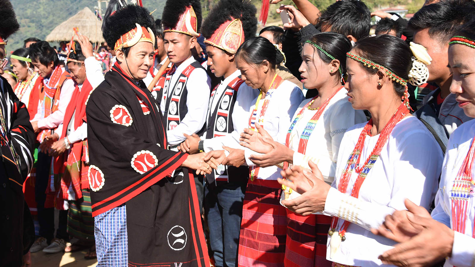 President U Win Myint is welcomed by Naga ethnic people in Leshi Township in Sagaing Region yesterday. Photo: MNA