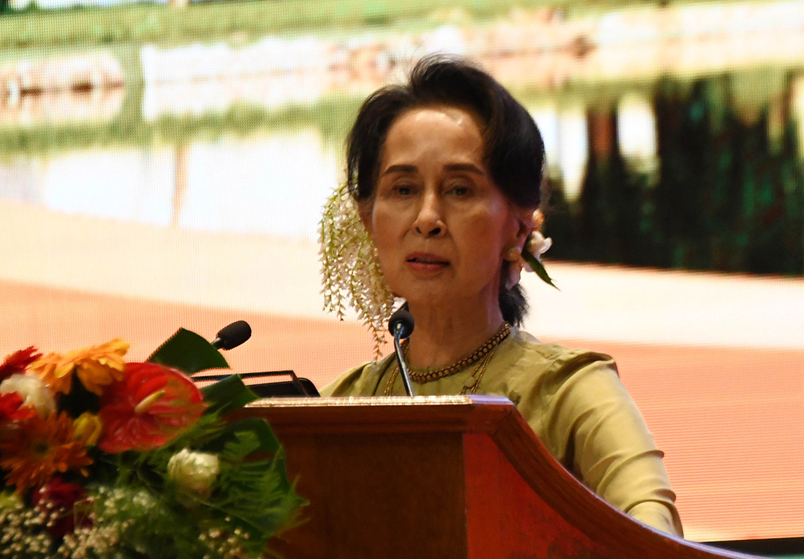 State Counsellor Daw Aung San Suu Kyi delivers the opening speech at the ceremony to mark the Myanmar-China 70th Anniversary of Establishment of Diplomatic Relations and launching of Myanmar-China Bilateral Cultural and Tourism Year in Nay Pyi Taw yesterday.Photo: MNA