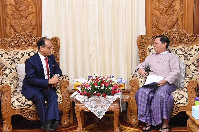 Union Minister Thura U Aung Ko meets with Nepali Ambassador Mr Bhim K. Udas in Nay Pyi Taw yesterday. Photo: MNA