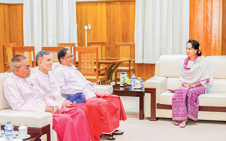 State Counsellor Daw Aung San Suu Kyi meets with New Mon State Party Chairman  Nai Han Thar and party at the NRPC in Nay Pyi Taw yesterday.Photo: MNA