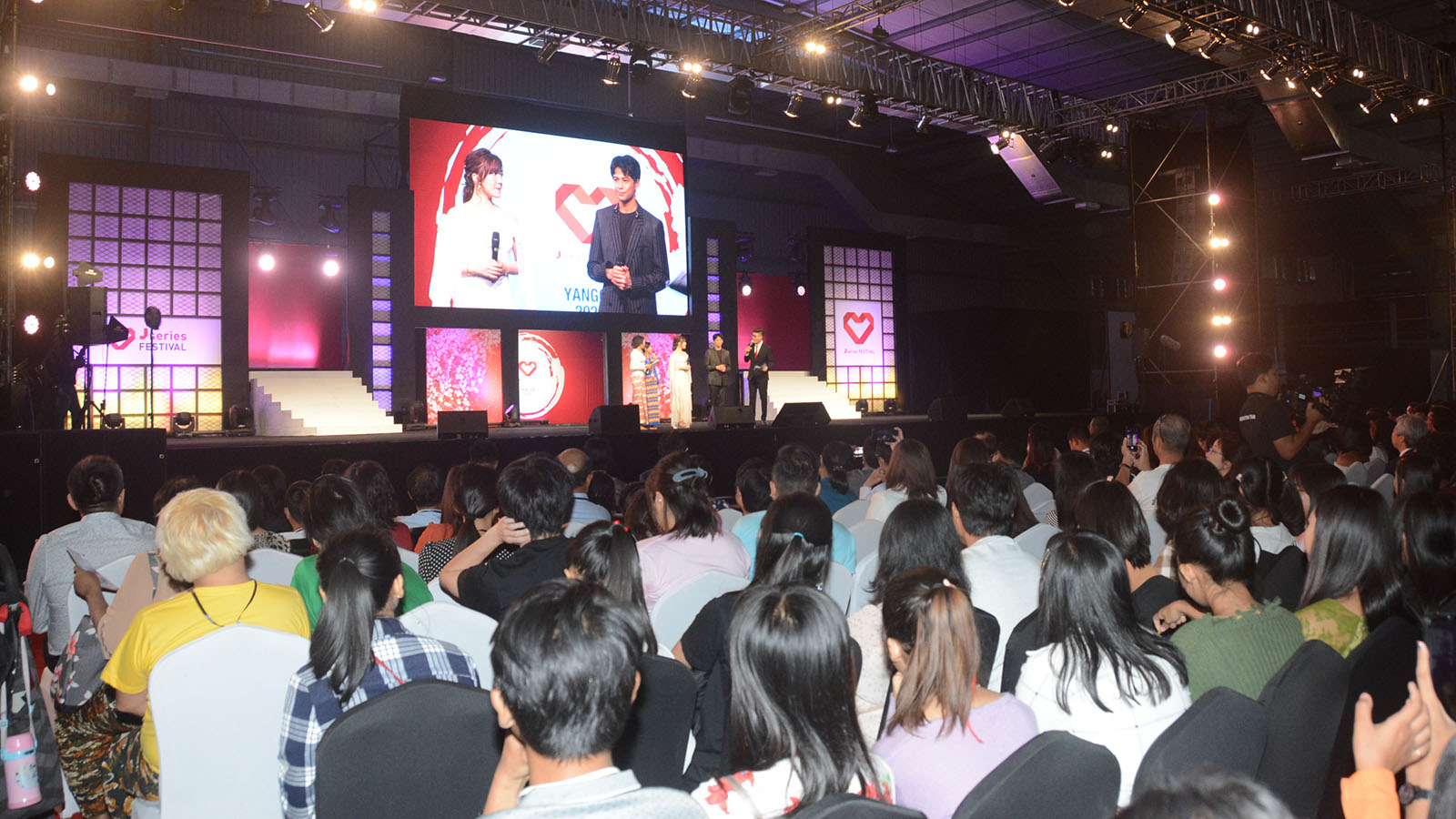 Audience enjoy the Japanese TV episodes at Yangon Convention Centre yesterday.Photos: Hla Moe