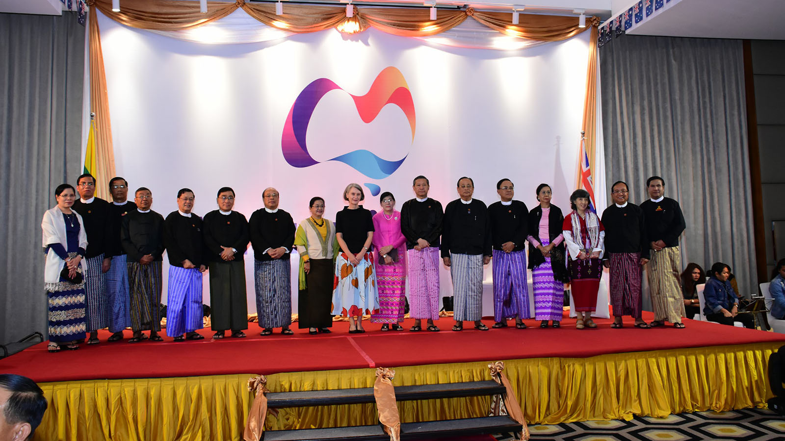 Union Minister Dr Myo Thein Gyi and wife, and Australian Ambassador Ms Andrea Faulkner pose for a group photo together with and attendees at the dinner reception to mark the Australian National Day in Nay Pyi Taw yesterday. Photo: MNA