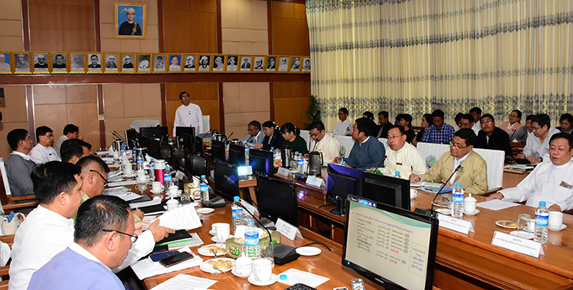 Deputy Minister U Aung Hla Tun attends the coordination meeting for accepting and scrutinizing tender for school textbooks in Nay Pyi Taw yesterday.Photo: MNA