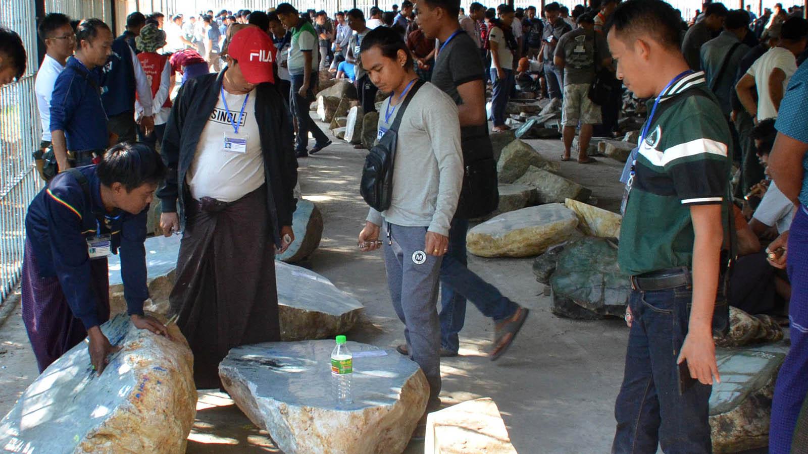 Jade merchants viewing jade lots at the Gems Emporium in Nay Pyi Taw yesterday.photo: Kyaw Zin Htike