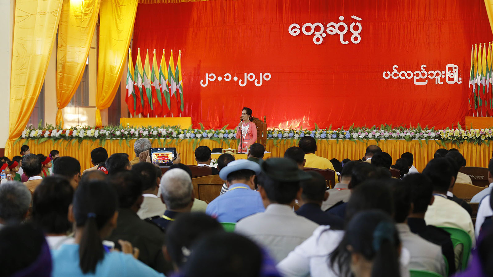 State Counsellor Daw Aung San Suu Kyi delivers the speech during the meeting with local people in Pinlebu Township in Sagaing Region yesterday. Photo: MNA