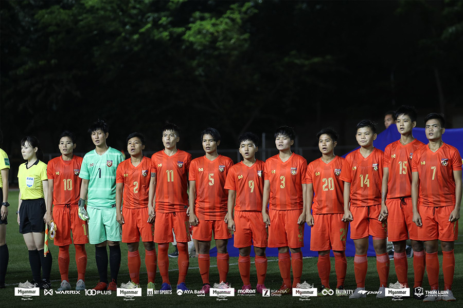 Myanmar's women's football team singing the national anthem at an international football match.Photo:MWL