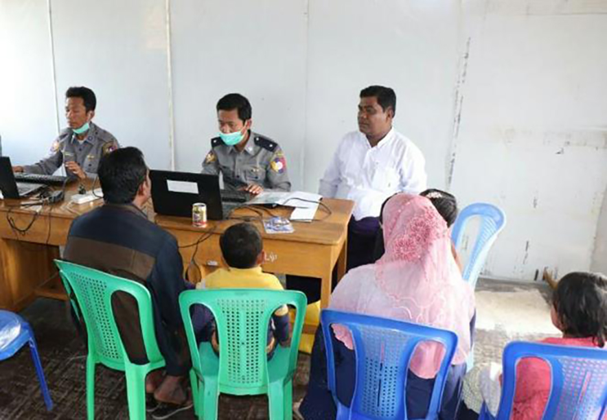 Officials from Nga Khu Ya Reception Centre working to issue National Verification Cards to the displaced persons in Maungtaw, Rakhine State yesterday. Photo: MNA