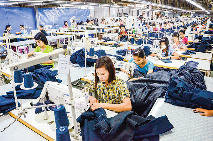 Workers sew garment at a factory in Yangon.Photo : Phoe Khwar
