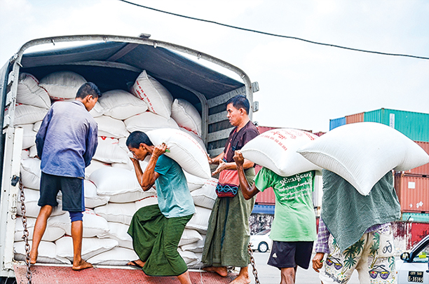 Workers loading the truck with sacks of rice at Botahtaung Jetty in Yangon .Photo : Phoe Khwar