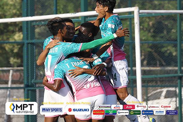 Yangon United players celebrating their victory after securing a 2-1 win over Chin United yesterday at their home stadium in Yangon. Photo: MNL