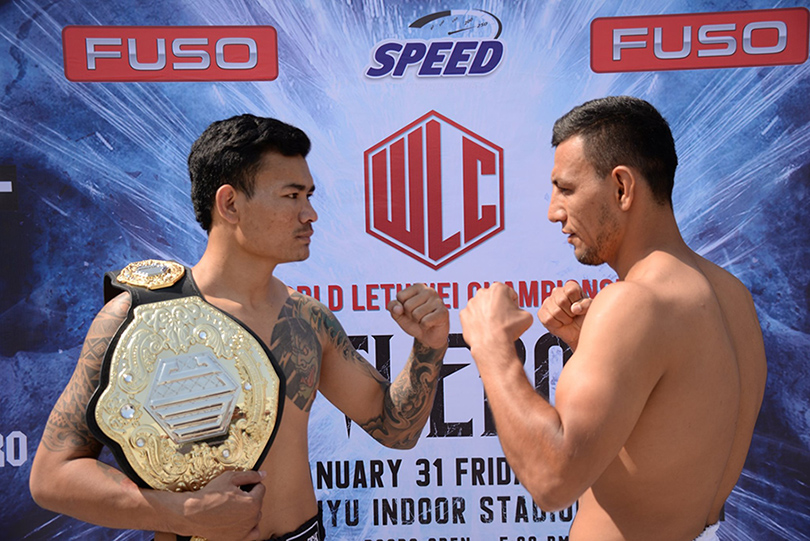 Myanmar lethwei star Too Too (l) and Muay Thai fighter NaimjonTuhtaboyev (R) pose for a photo ahead of the 'Battlebones' lethwei fight. Photo: WLC