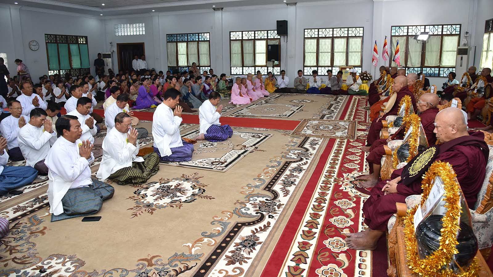 The congregation led by Senior General Min Aung Hlaing pay homage to the members of Sangha at the state driving ceremony at Kabar Aye Pagoda Road in Yangon yesterday.  Photo: Office of the C-In-C of Defence Services