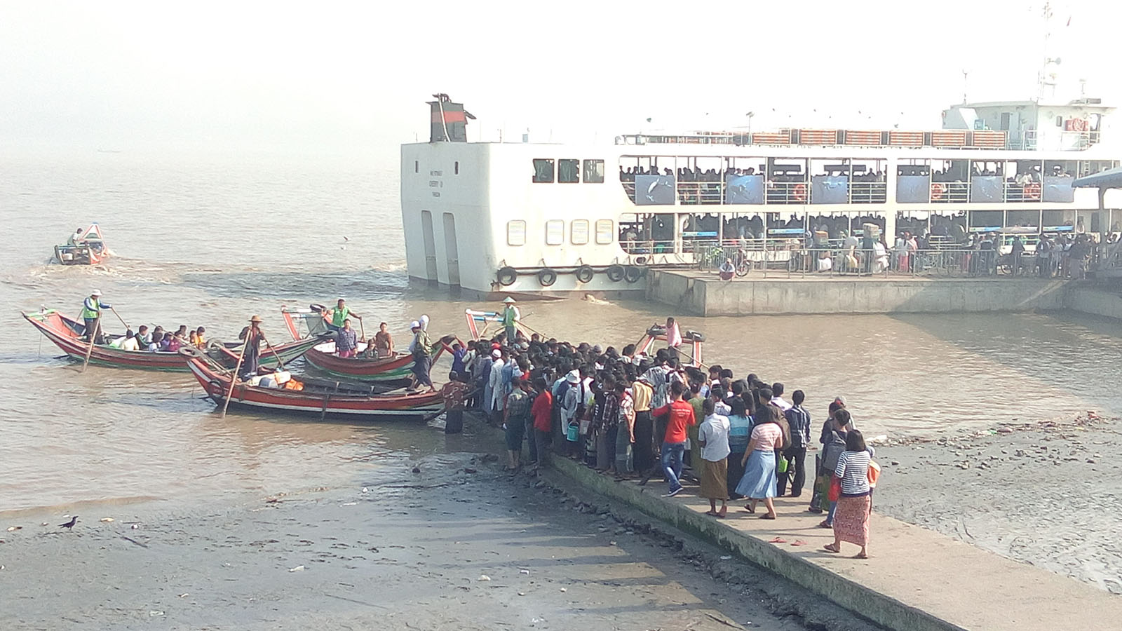 Passengers and ferry boats seen at the Dala Jetty,Yangon.   Photo: Naing Lin Kyaw (Dala)