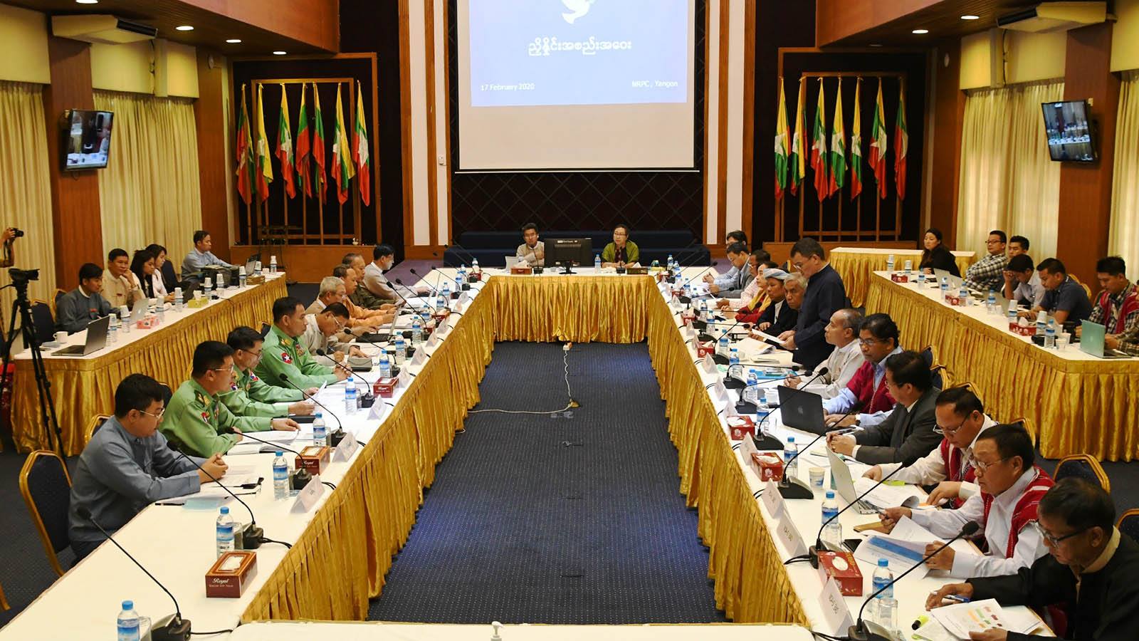 Government officials and representatives of EAOs meet in Yangon yesterday for implementing decisions of 8th JICM.Photo: Phoe Htaung