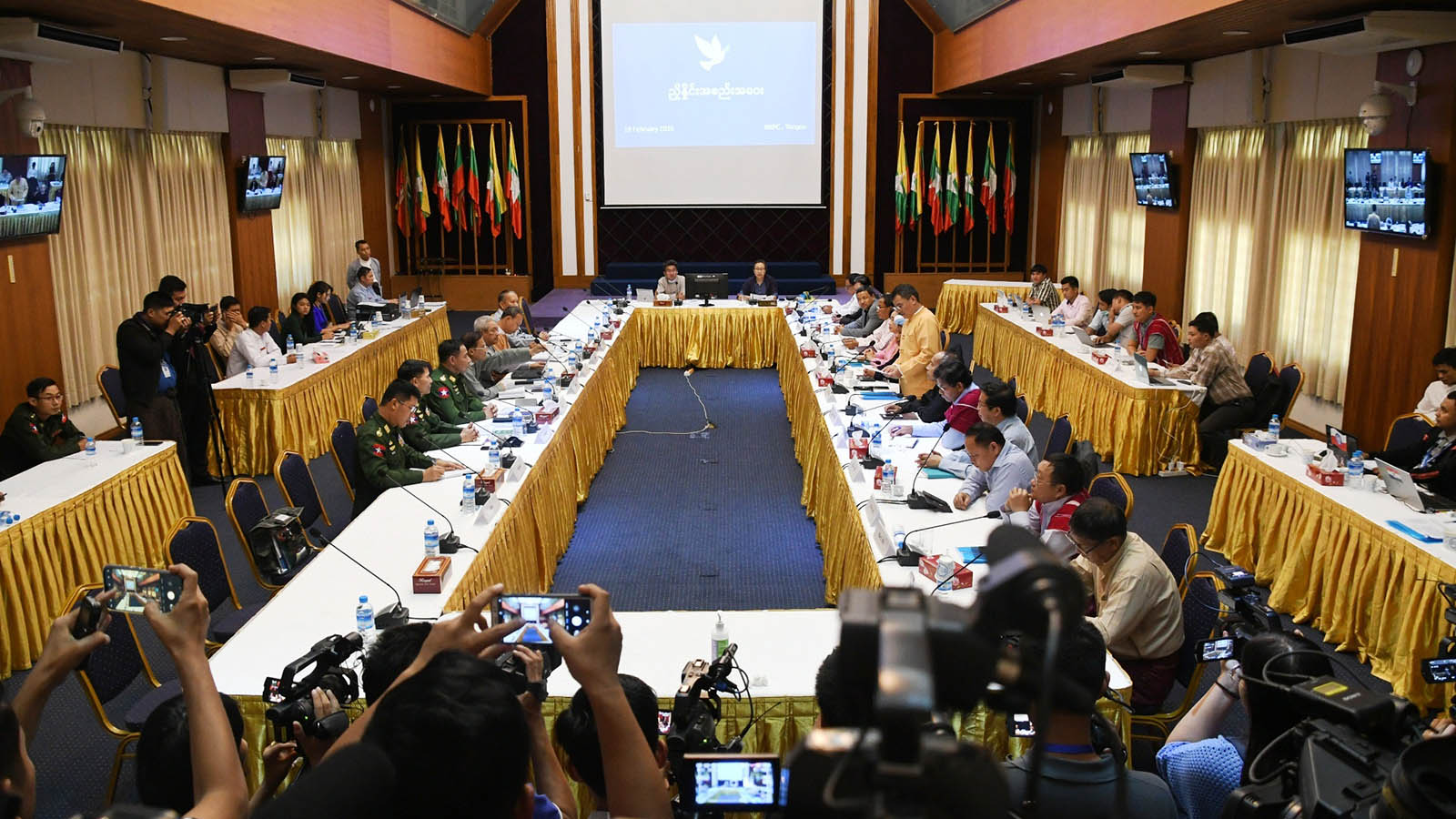 Government officials and representatives of ethnic armed organizations attend the meeting in Yangon yesterday.Photo: Phoe Htaung
