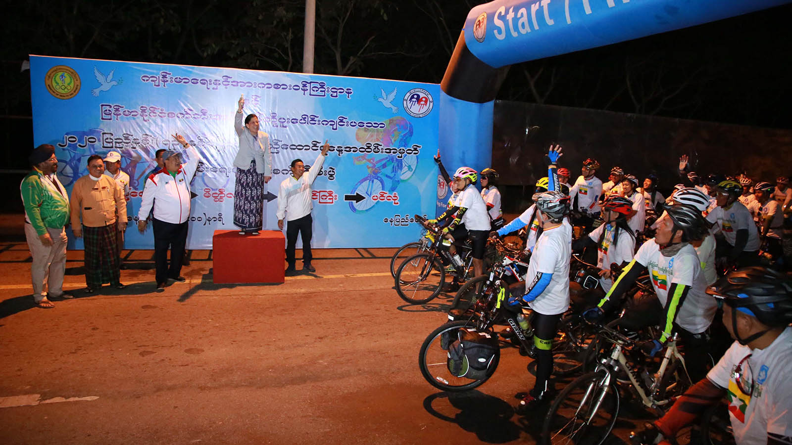 Deputy Minister for Health and Sports Dr Mya Lay Sein fires gun to start the peace cycling event in Nay Pyi Taw yesterday.Photo: MNA