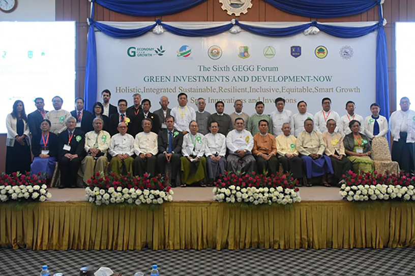 Yangon Region Chief Minister U Phyo Min Thein and attendees pose for a group photo at the Sixth Green Economy Green Growth (GEGG) Forum in Yangon on 6 February.Photo: Supplied