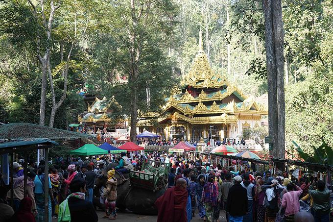 Pilgrims arrive at the Alaungdaw Kathapa cave shrine at the Alaungdaw Kathapa National Park in Kani Township for Tabodwe Festival.Photo: Than Htay Aung (Kani)