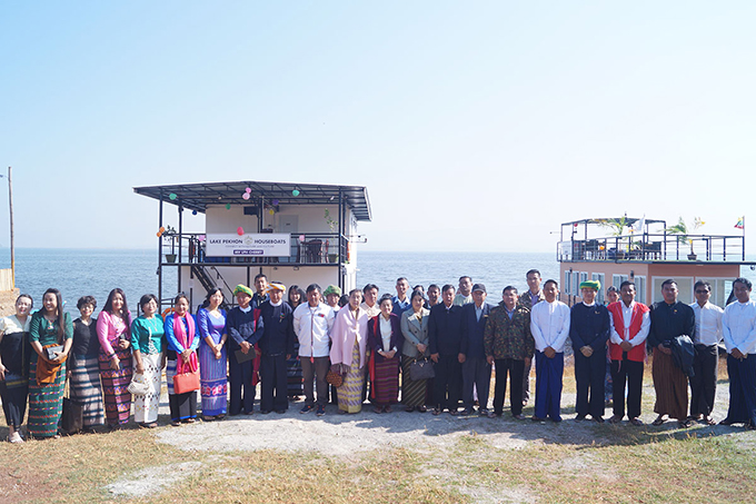Local ethnic people pose for a group photo as part of launching the two mini-cruise ships in Pekhon Lake in Southern Shan State. Photo: Maung Maung Htwe (IPRD)