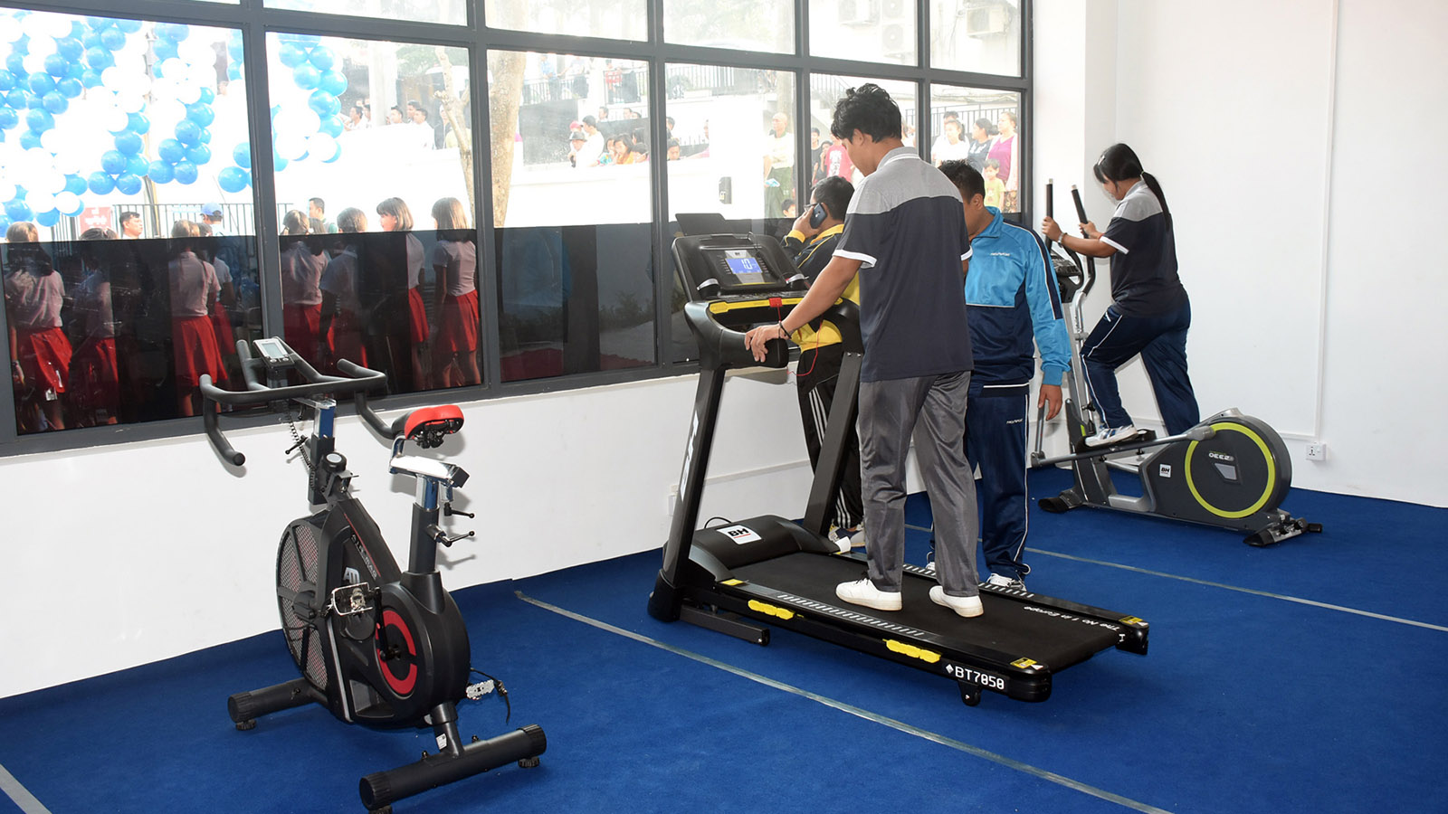 People use gym equipment inside the fitness centre of the Community Centre.  Photo: MNA