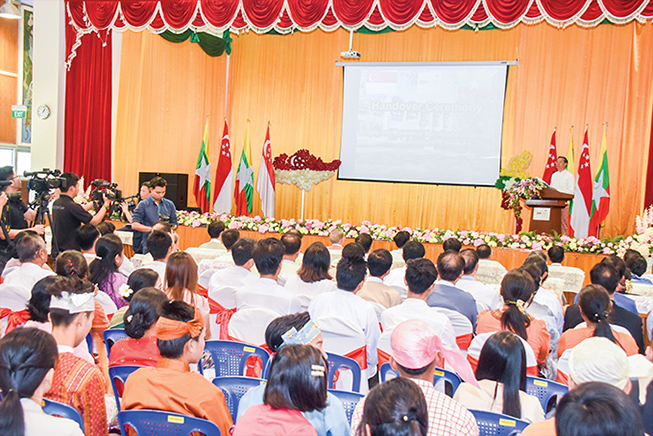 Union Minister Dr Myo Thein Gyi delivers the opening address at the handover ceremony of the Singapore-Myanmar Vocational Training Institute in Yangon yesterday. Photo: MNA