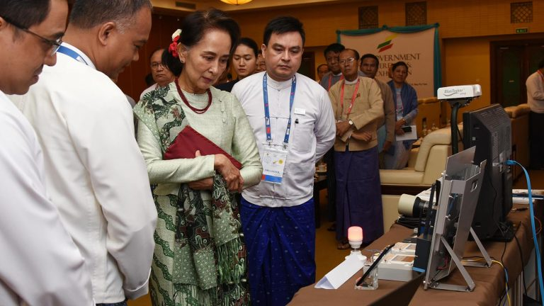 State Counsellor Daw Aung San Suu Kyi looks around the booths displayed at the 4th e-Government Conference & ICT Exhibition in Nay Pyi Taw yesterday.Photo: MNA