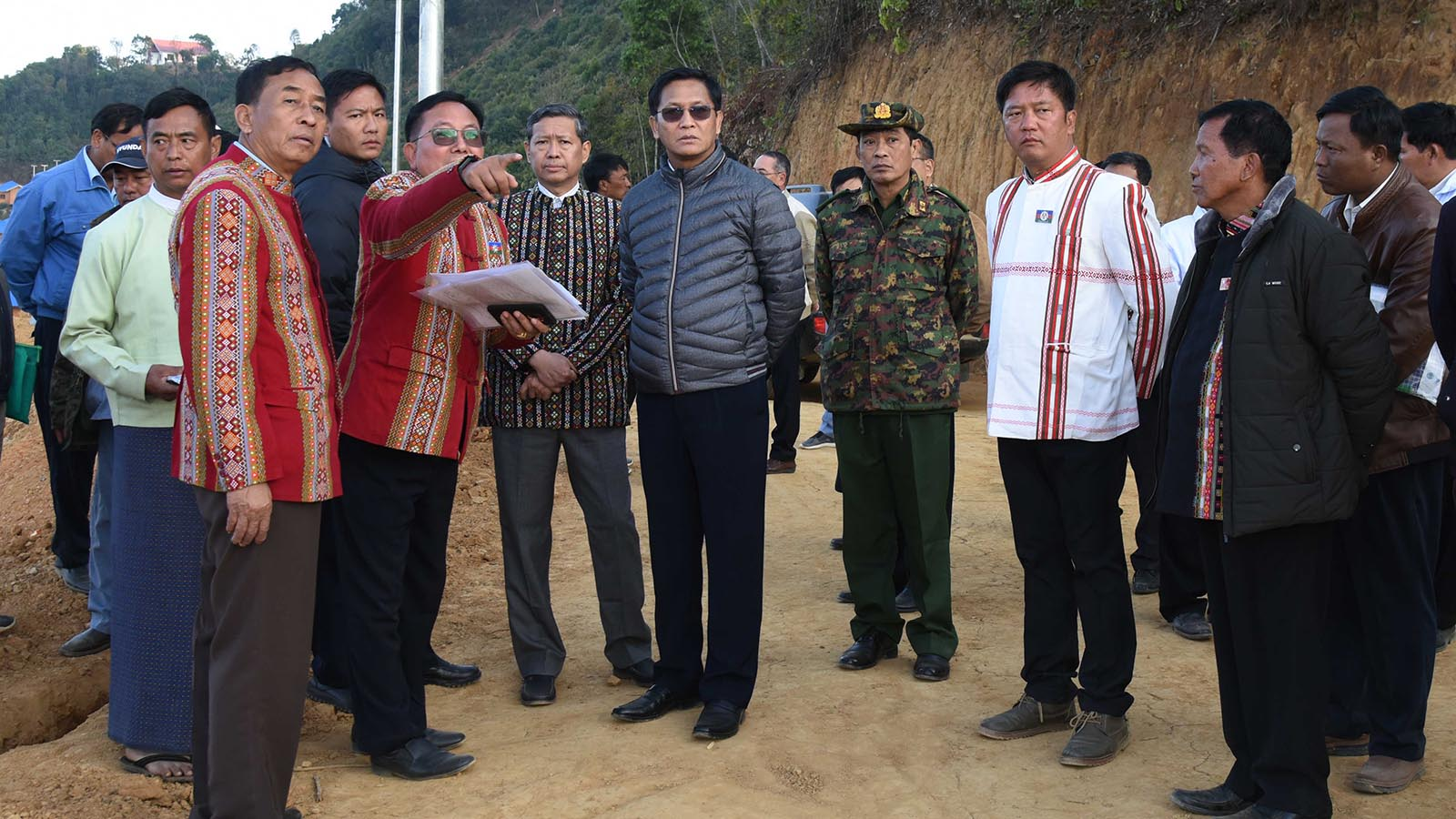 Vice President U Henry Van Thio inspects the construction work for houses donated by the Daw Khin Kyi Foundation, in Tikir Village, Chin State.Photo: MNA