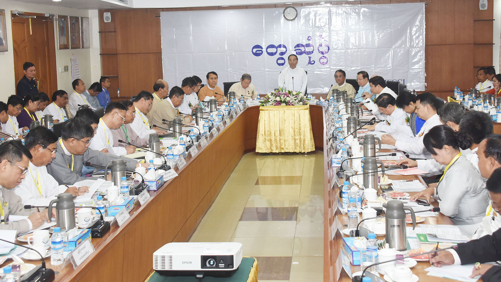 Vice President U Myint Swe addresses the 32nd regular meeting with Myanmar entrepreneurs at the Union of Myanmar Federation of Chambers of Commerce and Industry in Yangon yesterday. Photo: MNA