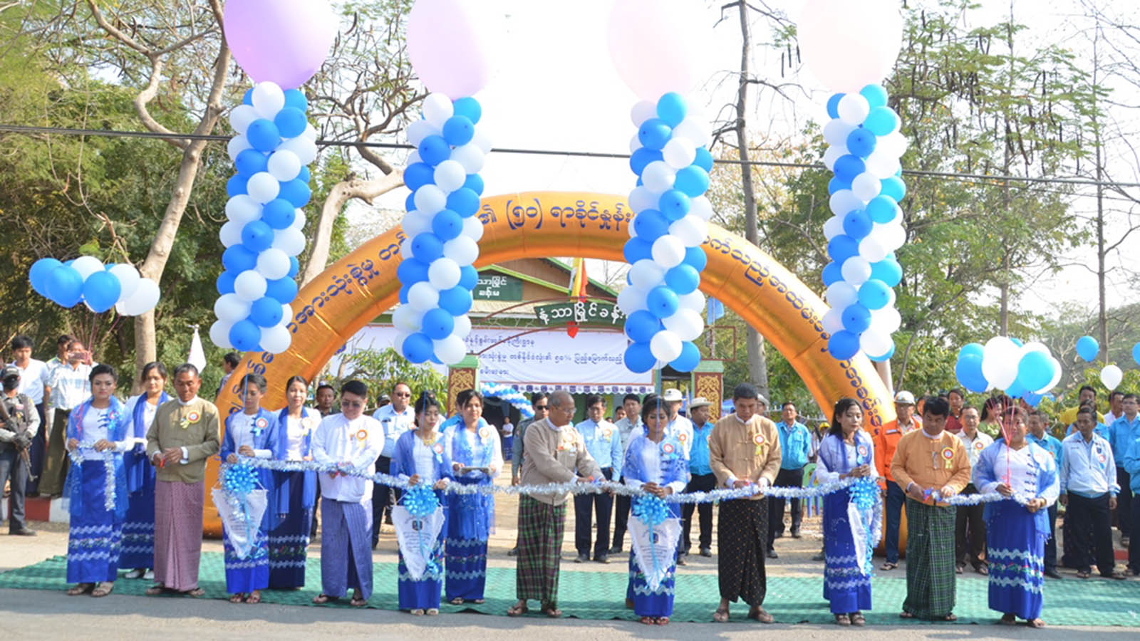 Officials cut the ribbon during the ceremony to mark electrification in 60 villages in Myaing Township in Magway Region.Photo: MNA