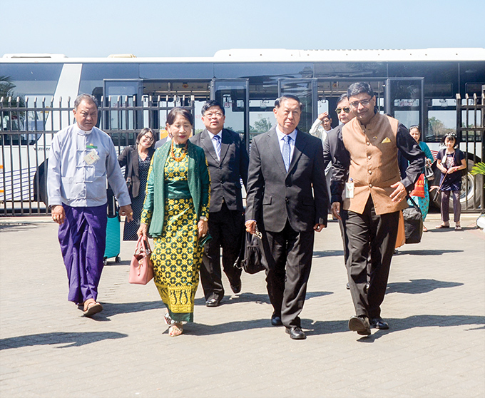 UEC Chairman U Hla Thein is welcomed back by officials from Indian Embassy at the Yangon International Airport in Yangon.Photo: MNA