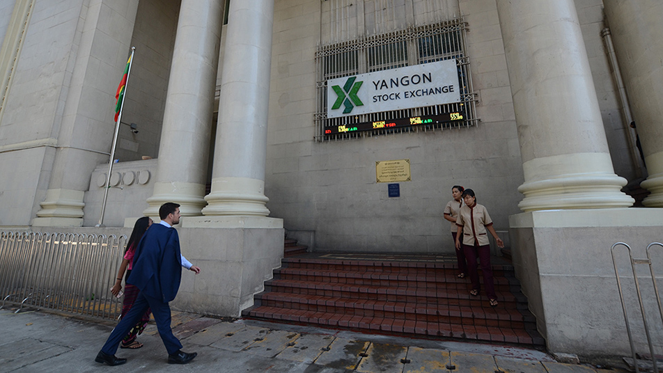 Visitors seen outside Yangon Stock Exchange in Yangon.  hoto: Phoe Khwar