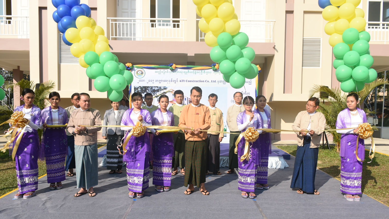 Yangon Region Chief Minister U Phyo Min Thein opens the staff housing in Yangon yesterday.  Photo: MNA