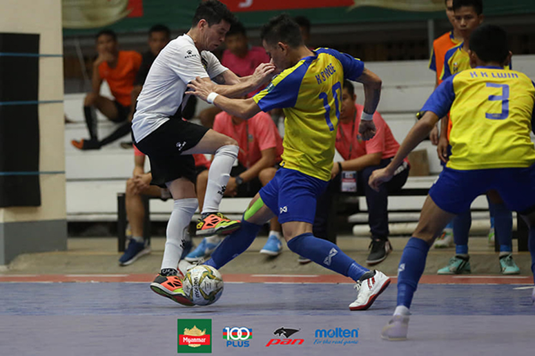 A VUC FC player (white) vies for the ball with an MIU FC player (yellow) during their previous meeting in the Myanmar National League 2019-2020. Photo: MFF Futsal