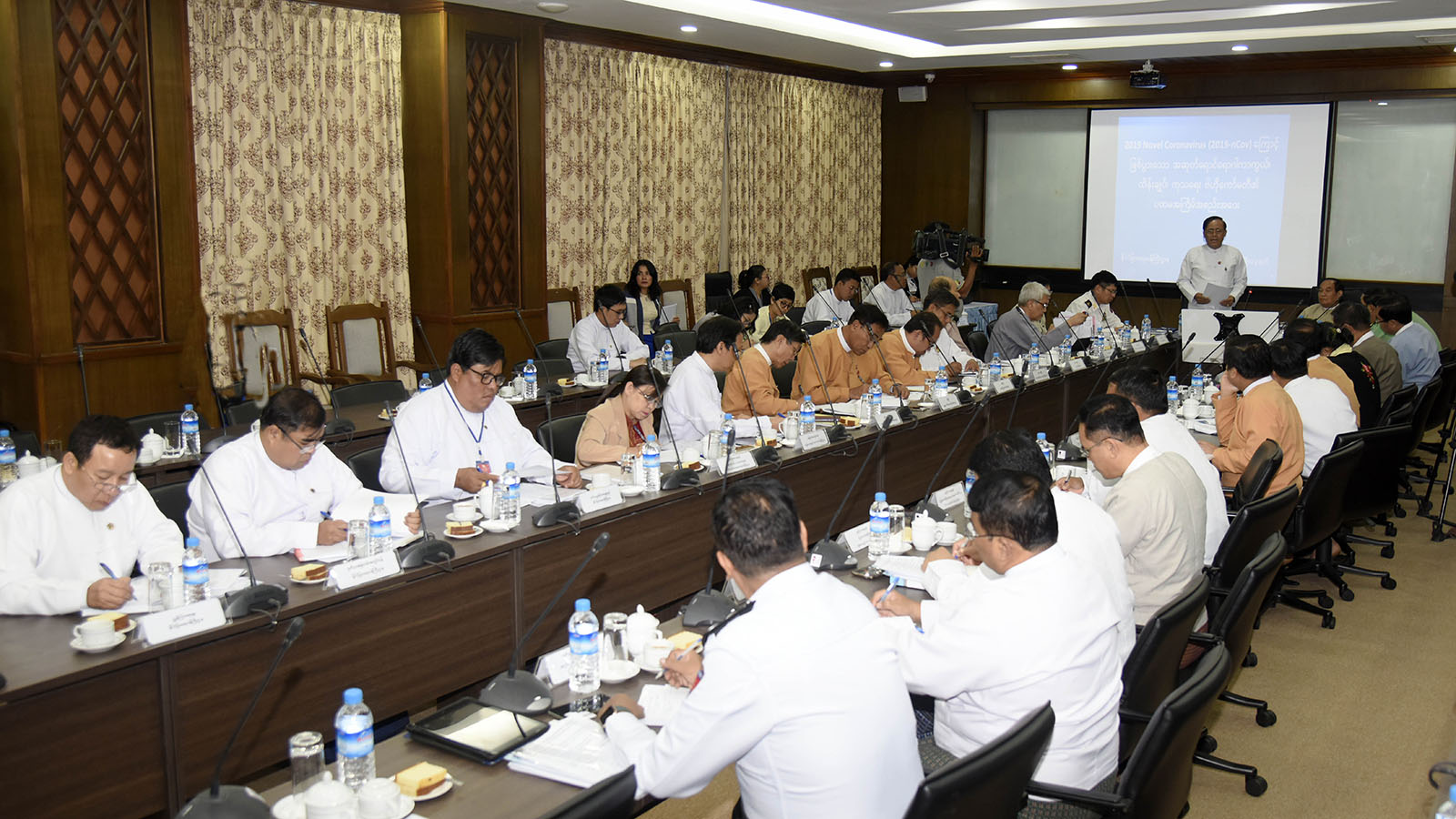 Union Minister U Kyaw Tin addresses the Central Committee Meeting on Prevention, Control and Treatment of 2019 Novel Coronavirus. Photo: MNA