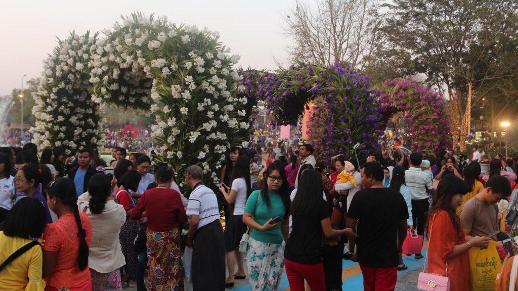 People enjoying the flower festival in Nay Pyi Taw yesterday.Photo:Hein Min Soe