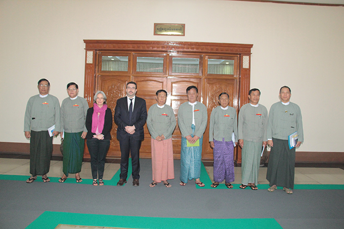 UEC Chairman U Hla Thein, Mr Holly Ruthrauff and delegation pose for a photo at the UEC office in Nay Pyi Taw yesterday. Photo: MNA