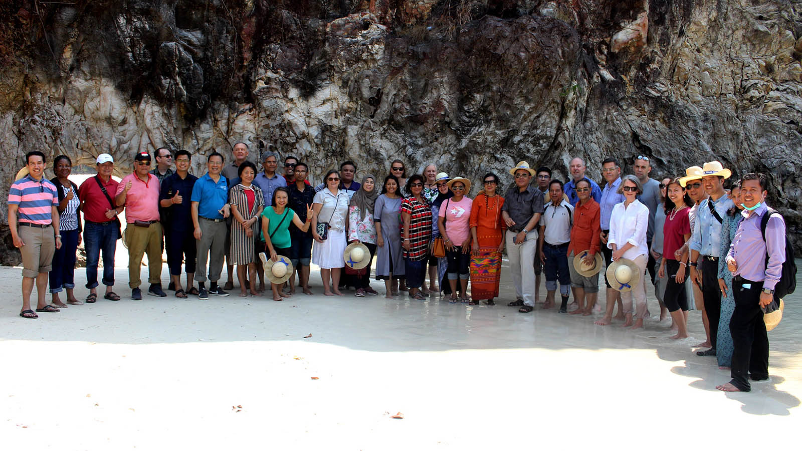 Union Minister U Kyaw Tin and diplomatic delegation pose for a documentary photo on the island at the Myeik Archipelago yesterday.Photo: MNA