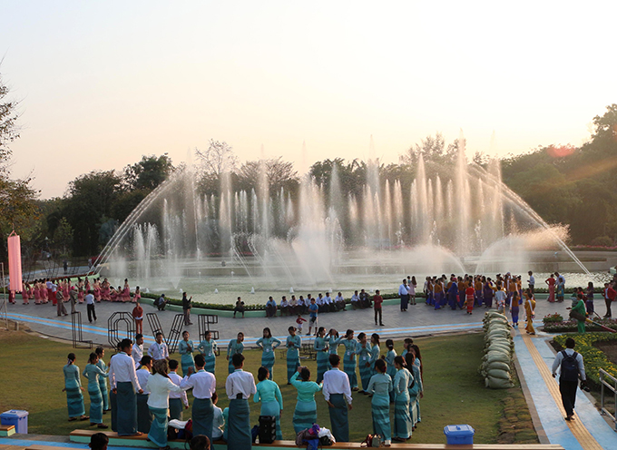 People relax at the Nay Pyi Taw Water Fountain Garden. Photo: Hein Min Soe