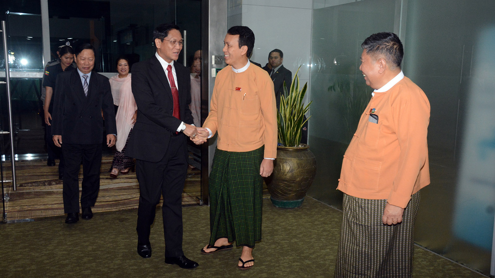 Vice President U Henry Van Thio is welcomed back by Yangon Region Chief Minister U Phyo Min Thein at the Yangon International Airport. Photo: MNA