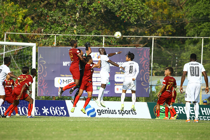 Players from Shan United (white) and Ayeyawady United (red) vying for the ball at yesterday's Week-4 match at home stadium of Ayeyawady in Pathein. Photo: AUFC